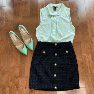 Mint green button down sleeveless shirt